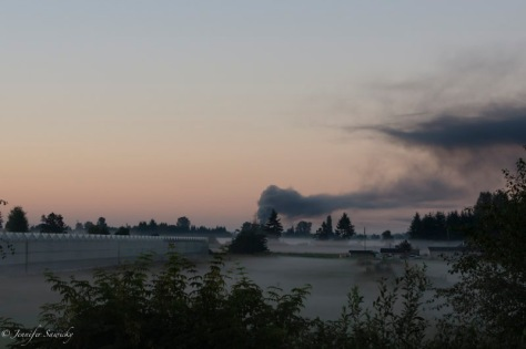 For this shot I was about 3 kilometres away; the black smoke dominates the morning skyline.