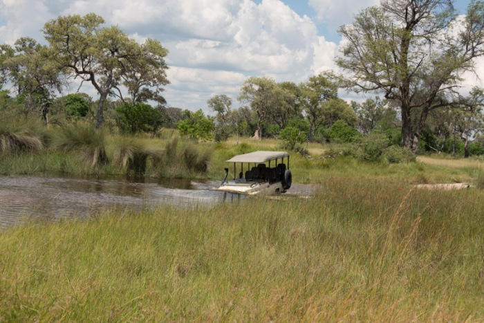 Water crossing!  One of the camp vehicles carrying luggage from the airstrip to the camp.